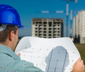 Look at the drawings of the building engineer with the fuzzy building background 03