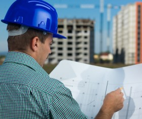 Look at the drawings of the building engineer with the fuzzy building background 04