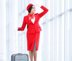 Looking out the window of the stewardess and suitcase Stock Photo
