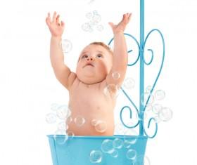 Lovely happy baby bathing Stock Photo