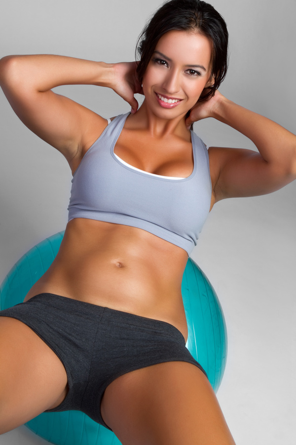 Lying on a stretch ball to do fitness for women HD picture