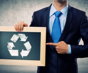 Male people hands holding frame recycling sign and gray background photo