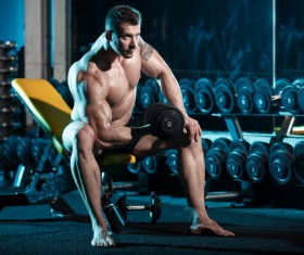 Man with a dumbbell in the gym exercise arm HD picture