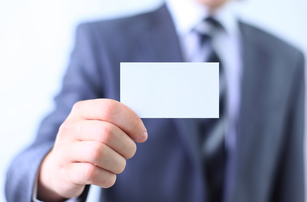 People holding a blank business card with background blur 01
