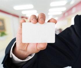 People holding a blank business card with background blur 02