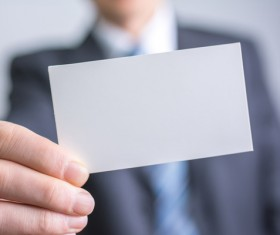 People holding a blank business card with background blur 03