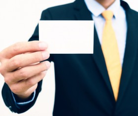 People holding a blank business card with background blur 04