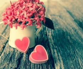 Pink flowers and pink heart-shaped on the table Stock Photo