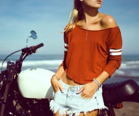 Pretty hipster girl with motorbike stock photo