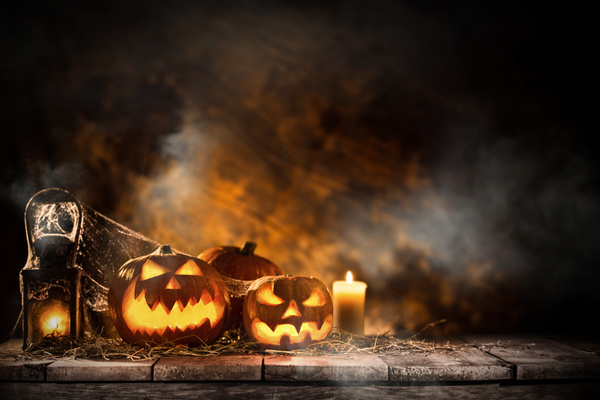 Pumpkin on old wooden table flame background Stock Photo 01