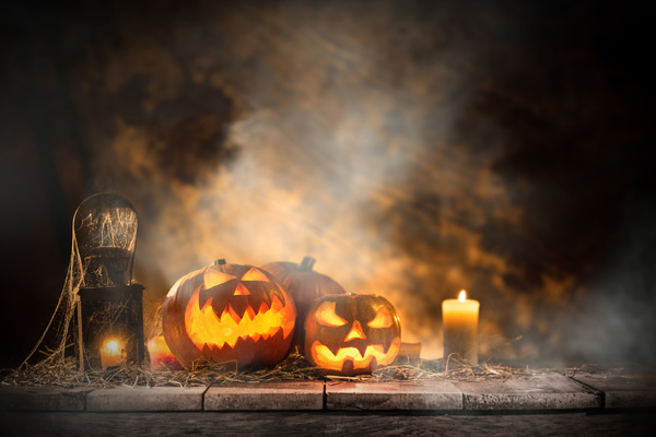 Pumpkin on old wooden table flame background Stock Photo 02