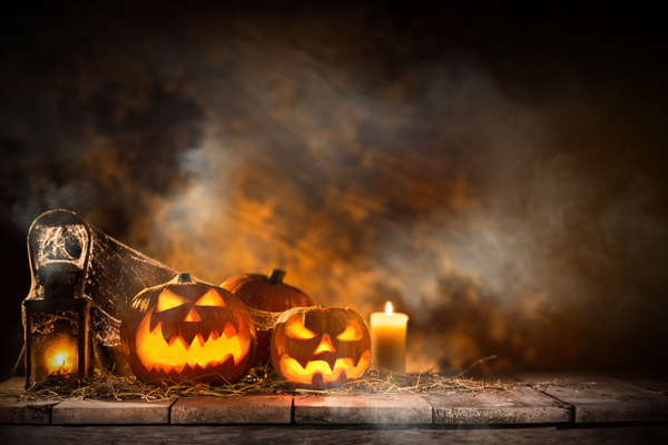 Pumpkin on old wooden table flame background Stock Photo 03