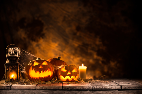 Pumpkin on old wooden table flame background Stock Photo 06
