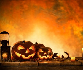 Pumpkin on old wooden table flame background Stock Photo 07