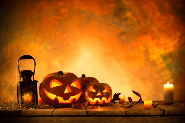 Pumpkin on old wooden table flame background Stock Photo 08