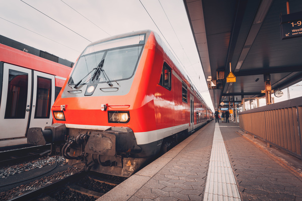 Red tram stop at the station Stock Photo