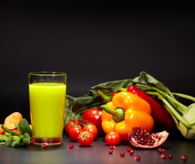 Red vegetables with green vegetable juice Stock Photo