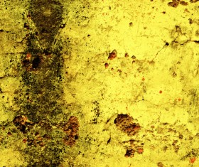 Scratched texture on yellow wall Stock Photo