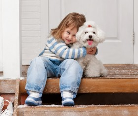 Smiling girl posing with puppy Stock Photo
