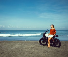 Stock Photo Pretty hipster girl Biker on the beach
