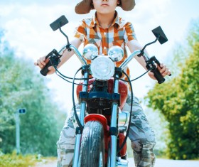 Sunny day riding a motorcycle boy Stock Photo
