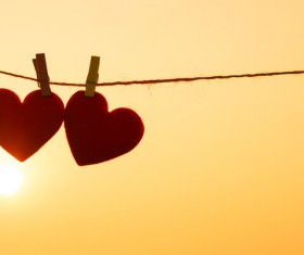 Sunset under the two Valentine's Day heart Stock Photo
