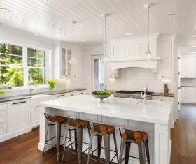The bright, spacious white chandelier ceiling kitchen and center island
