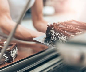 The cake maker who is making the chocolate cake