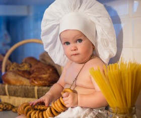 The cook costume Baby holding cookies Stock Photo