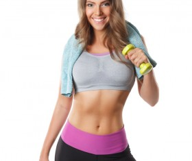 Towel ride on the shoulders of young women do dumbbell movement