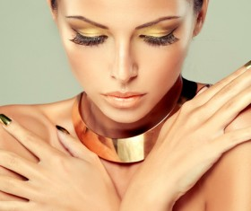 With a gold necklace fashion woman eyelashes beauty nail