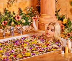 Women relaxing spa water bath petals Stock Photo