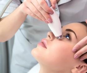 Young beautiful woman doing skin checks