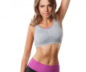 Young beautiful woman holding double dumbbell exercise
