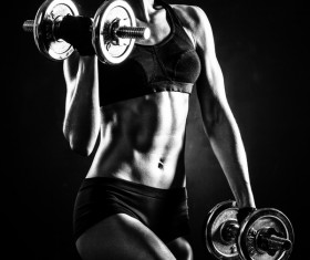 Young confident woman doing biceps curl exercise 01