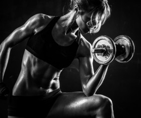 Young confident woman doing biceps curl exercise 03