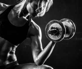Young confident woman doing biceps curl exercise 04