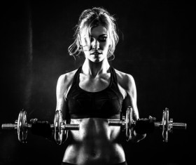 Young confident woman doing biceps curl exercise 05