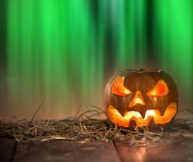 reen background with pumpkin lights
