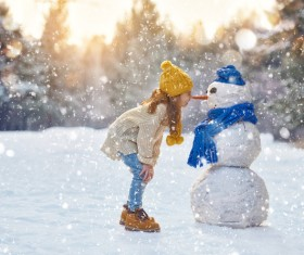 And snow children close interaction with children Stock Photo