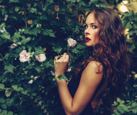 Beautiful young happy woman with garden HD picture