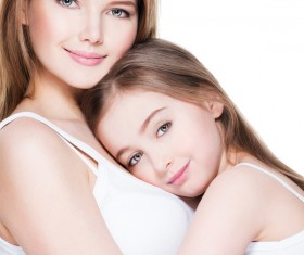 Beautiful young mother with arms in the daughter Stock Photo