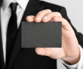 Business people with black business cards Stock Photo