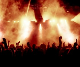 Cheering crowd of rock concerts with fireworks