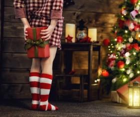Christmas girl holding a gift Stock Photo