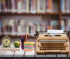 Desktop typewriter pencil case and clock Stock Photo
