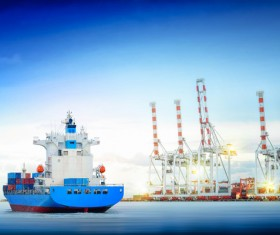 Freighter sailing with quay cranes HD picture