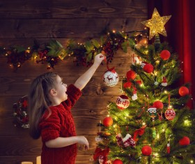 Girl decorating christmas tree Stock Photo