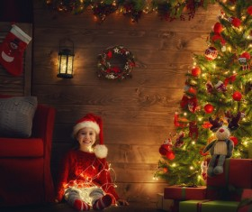 Girl with Christmas tree covered with gifts Stock Photo