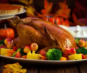 Golden roast turkey with corn fruit and vegetable decoration Stock Photo